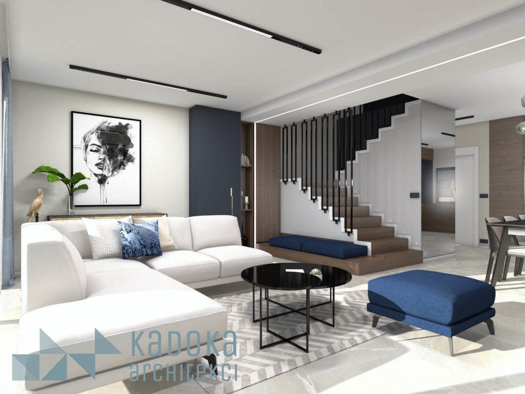 Nowoczesny salon z duzym lustrem na scianie oraz schodami w okładzinie drewnianej i czarną balustradą.