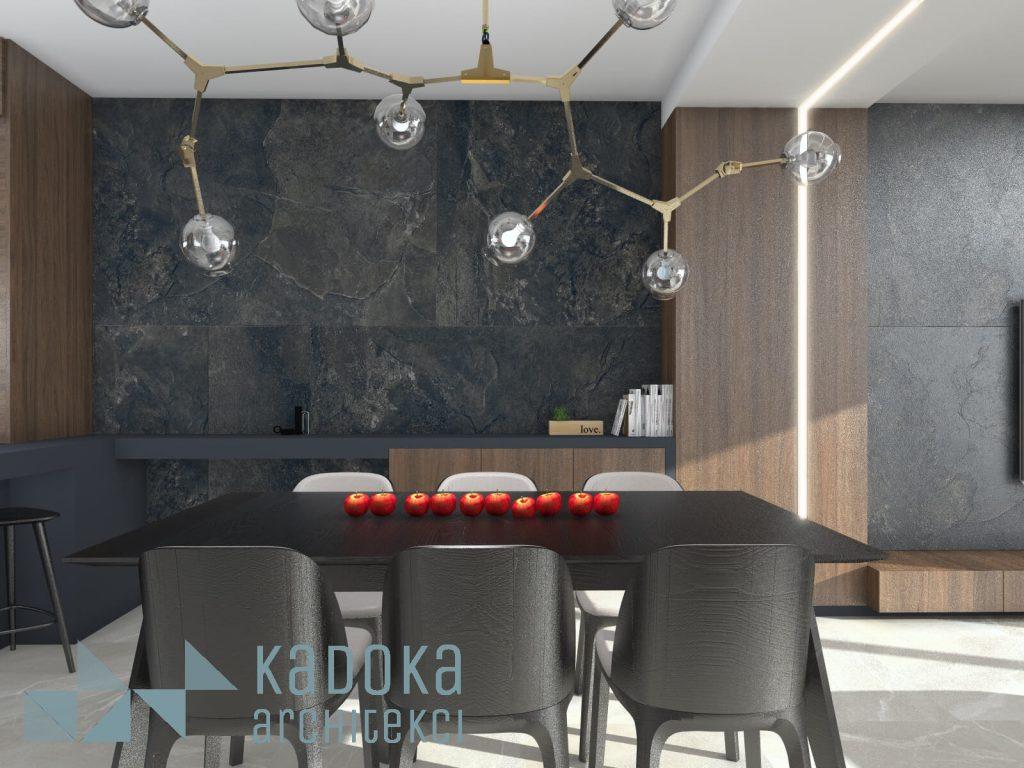 Nowoczesny salon z kuchnią z okładziną ścienną z płytek wielkoformatyowych Tubądzin Grand Cave graphite.
