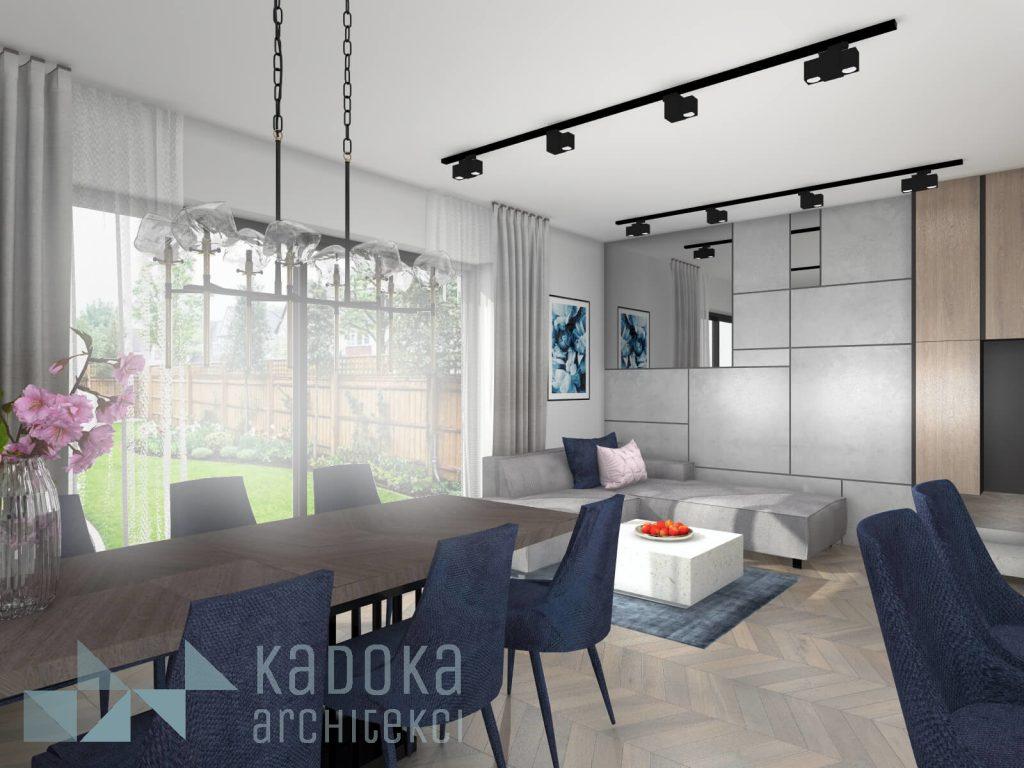 Nowoczesny salon z geometryczną okładziną betonową na ścianie oraz granatowymi akcentami.